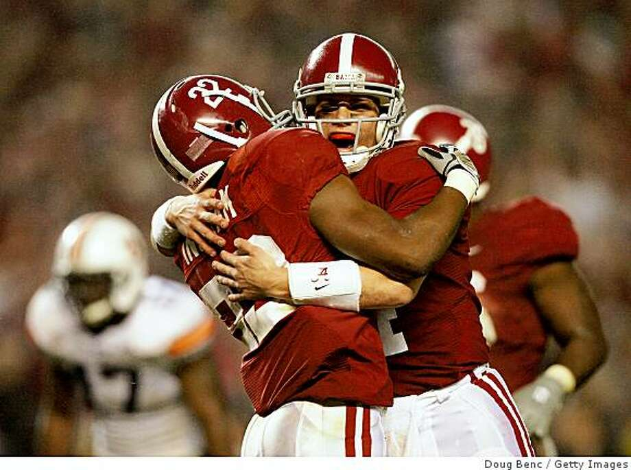 TUSCALOOSA, AL - NOVEMBER 29:  Quarterback John Parker Wilson #14 and running back Mark Ingram #22 of the Alabama Crimson Tide celebrate after Ingram's touchdown run in the third quarter against the Auburn Tigers at Bryant-Denny Stadium on November 29, 2008 in Tuscaloosa, Alabama. Alabama defeated Auburn 36-0.  (Photo by Doug Benc/Getty Images) Photo: Doug Benc, Getty Images