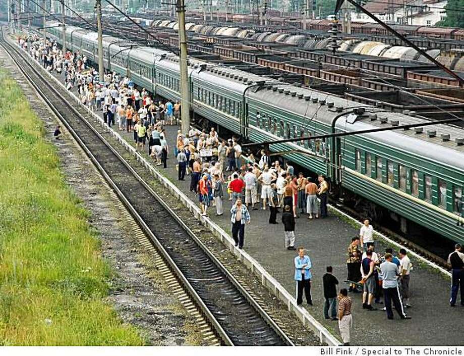 Passengers disembark the train to shop for snacks from vendors. Photo: Bill Fink, Special To The Chronicle