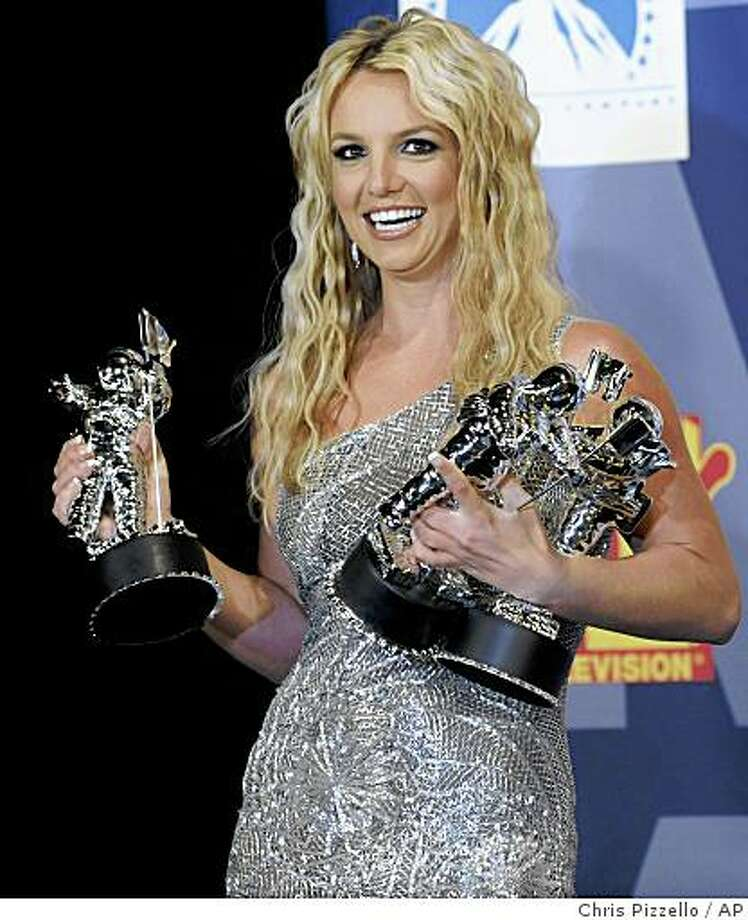 Britney Spears poses with her awards backstage at the 2008 MTV Video Music Awards held at Paramount Pictures Studio Lot on Sunday, Sept. 7, 2008, in Los Angeles. Photo: Chris Pizzello, AP