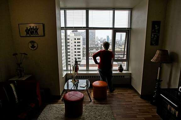 Milana Trilesskaya, looks out her window over the south of Market area, on Thursday June 24, 2010, was one of the first residents to move into the 10TH and Mission Family Housing, a Mercy housing Community, in  San Francisco, Ca.