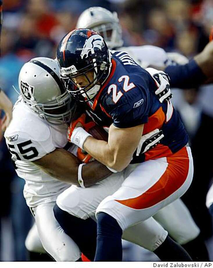 Oakland Raiders linebacker Jon Alston, left, stops Denver Broncos running back Peyton Hills after a short gain in the first quarter of an NFL football game in Denver on Sunday, Nov. 23, 2008. (AP Photo/David Zalubowski) Photo: David Zalubowski, AP