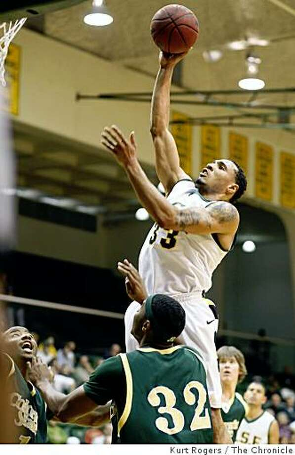 USF's Dior Lowhorn for two over Colorado's Andy Ogide in the first halfColorado State 63-USF 65 on Saturday Nov 29,  2008 in San Francisco, Calif Photo: Kurt Rogers, The Chronicle