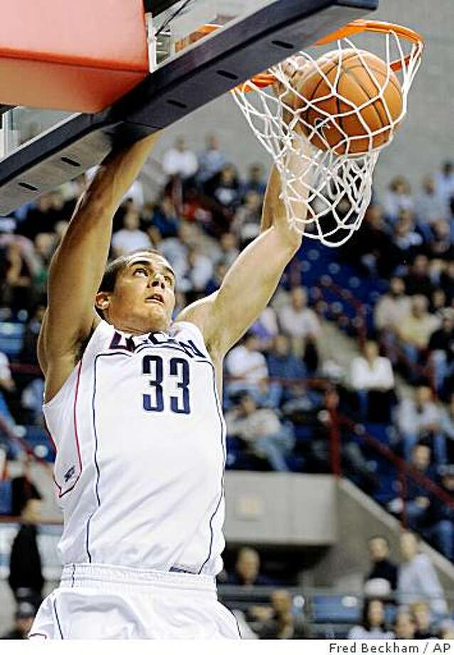 Connecticut's Gavin Edwards scores two of his team-high 17 points against Delaware State during his teams 79-49 victory in their NCAA college men's basketball game in Storrs, Conn., on Monday, Dec. 1, 2008.  (AP Photo/Fred Beckham) Photo: Fred Beckham, AP