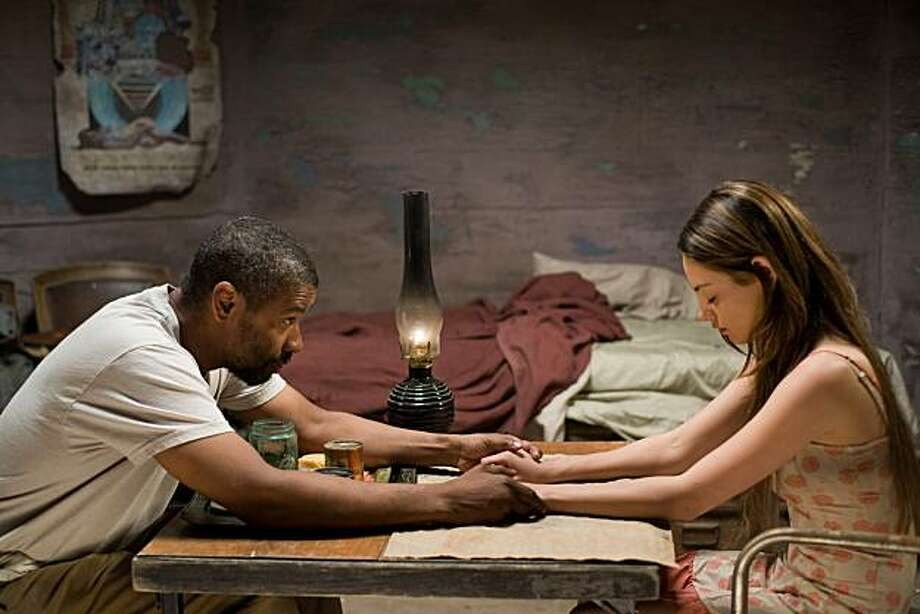 DENZEL WASHINGTON as Eli and MILA KUNIS as Solara in Alcon EntertainmentÕs action adventure film ÒThe Book of Eli,Ó a Warner Bros. Pictures release. Photo: David Lee, Warner Bros. Entertainment Inc.
