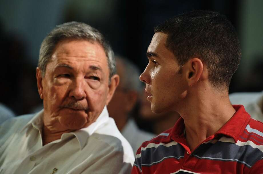 Cuba's President Raul Castro, left, and Elian Gonzalez attend an official event in Havana, Wednesday, June 30, 2010. Castro and a now 16-year-old Gonzalez attended an official event marking the 10-year anniversary of the time when the former cast away child whose mother died at sea became the center of a politically-charged international custody battle, ending with his repatriation to Cuba and his father. Photo: Adalberto Roque, AP