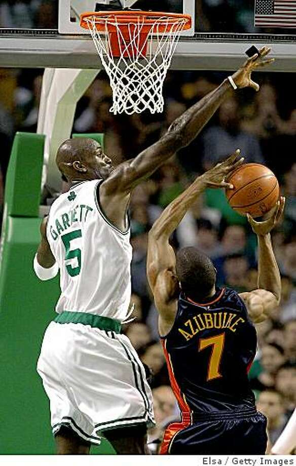 BOSTON - NOVEMBER 26: Kevin Garnett #5 of the Boston Celtics blocks a shot by Kelenna Azubuike #7 of the Golden State Warriors on November 26,2008 at TD Banknorth Garden in Boston, Massachusetts. NOTE TO USER: User expressly acknowledges and agrees that, by downloading and or using this Photograph, user is consenting to the terms and conditions of the Getty Images License Agreement. (Photo by Elsa/Getty Images) Photo: Elsa, Getty Images