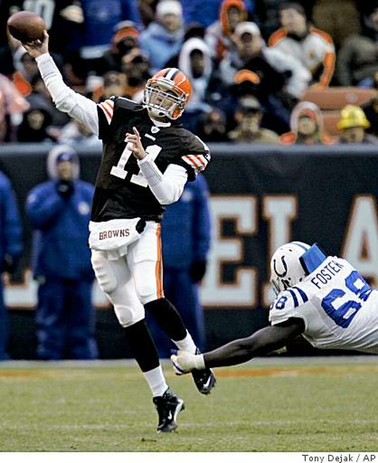 Cleveland Browns quarterback Ken Dorsey throws an incomplete pass under pressure from Indianapolis Colts defensive tackle Eric Foster during the fourth quarter in an NFL football game Sunday, Nov. 30, 2008, in Cleveland. Derek Anderson sprained a knee ligament in the final two minutes and is likely done for the season. Browns coach Romeo Crennel said Dorsey will start next Sunday at Tennessee. The Colts won 10-6. (AP Photo/Tony Dejak) Photo: Tony Dejak, AP