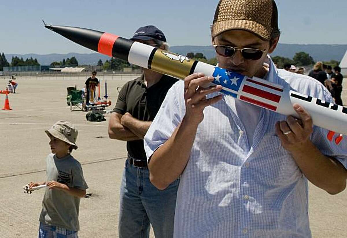 Randy Tan, 41, of San Carlos, Calif., gives his rocket a good-luck kiss following a succesful inspection and prior to its launch during the Livermore Unit of the National Association of Rocketry's monthly low-power rocket launch session on Saturday, June 26, 2010 at Moffett Field/NASA Ames Research Center in Mountain View, Calif.