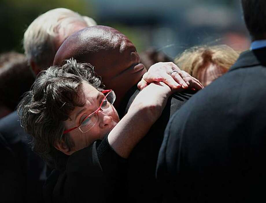 After the funeral of Walter H. Shorenstein (February 15, 1915 Ð June 24, 2010),  San Francisco billionaire real estate developer and investor, his daughter Carole Shorenstein Hays receives a hug from Barry Bonds in front of Temple Emanu-el in San Francisco, Calif., on Monday, June 28, 2010. Photo: Liz Hafalia, The Chronicle