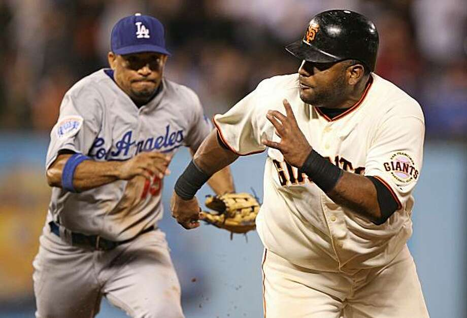 SAN FRANCISCO - JUNE 28:  Pablo Sandoval #48 of the San Francisco Giants is caught in a run down in the seventh inning as Rafael Furcal #15 of the Los Angeles Dodgers applies the tag in the seventh inning during an MLB game at AT&T Park on June 28, 2010 in San Francisco, California. Photo: Jed Jacobsohn, Getty Images