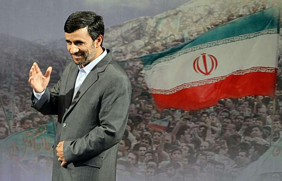 """Iranian President Mahmoud Ahmadinejad gestures after speaking to the press in Tehran on June 28, 2010, saying that Iran will """"discipline"""" the West by holding off talks with world powers over Tehran's nuclear programme until the end of August. The hardliner said that Iran would also seek the inclusion of Brazil and Turkey in nuclear fuel swap negotiations with the United States, France and Russia. Photo: Atta Kenare, AFP/Getty Images"""