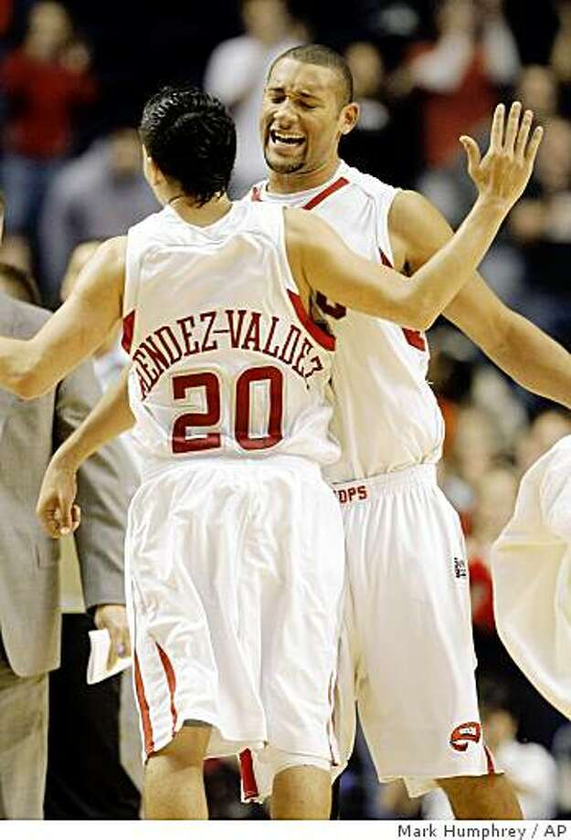 Western Kentucky's Orlando Mendez-Valdez (20) and D.J. Magley celebrate during a timeout against Louisville in the second half of an NCAA college basketball game in Nashville, Tenn., Sunday, Nov. 30, 2008. Western Kentucky upset No. 3 Louisville 68-54. (AP Photo/Mark  Humphrey) Photo: Mark Humphrey, AP