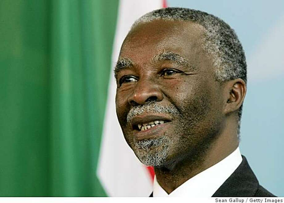 BERLIN - JULY 8:  South African President Thabo Mbeki speaka to the media after talks with German Chancellor Angela Merkel July 8, 2006 in Berlin, Germany. Mbeki is in Berlin to see the final match of the FIFA World Cup 2006. South Africa will hold the World Cup in 2010.  Mbeki's office said he had agreed to resign after his ruling African National Congress's National Executive Committee announced that it would remove him from office before the end of hi sterm in April on September 20, 2008.  (Photo by Sean Gallup/Getty Images) Photo: Sean Gallup, Getty Images