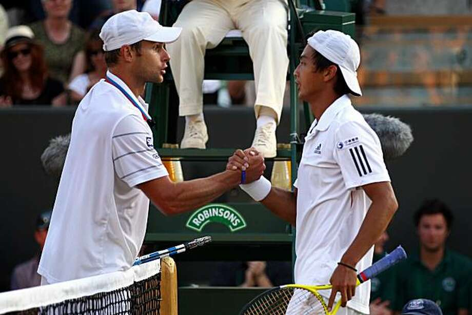 LONDON, ENGLAND - JUNE 28:  Yen-Hsun Lu of Taipei greets Andy Roddick of USA after defeating him on Day Seven of the Wimbledon Lawn Tennis Championships at the All England Lawn Tennis and Croquet Club on June 28, 2010 in London, England. Photo: Clive Brunskill, Getty Images
