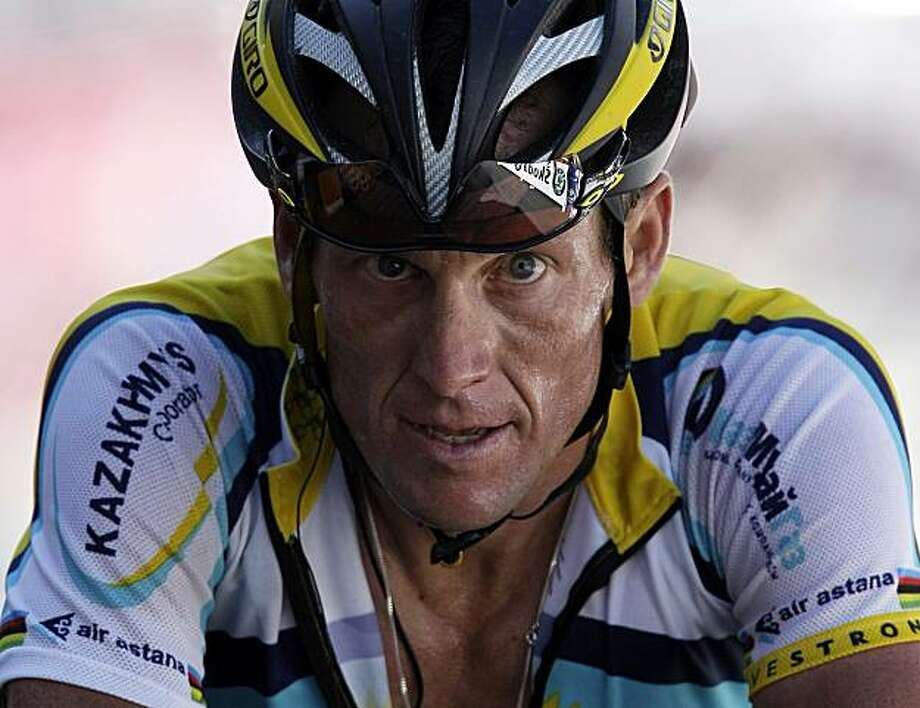 FILE - In this July 19, 2009, file photo, American seven-time Tour de France winner Lance Armstrong crosses the finish line during 15th stage of the Tour de France cycling race over 207.5 kilometers (129 miles) which started in Pontarlier, France and finished in Verbier, Switzerland. Armstrong is giving the Tour de France one last go, and two-time winner Alberto Contador is the man to beat again when the three-week cycling extravaganza starts on Saturday. Photo: Laurent Rebours, File, AP