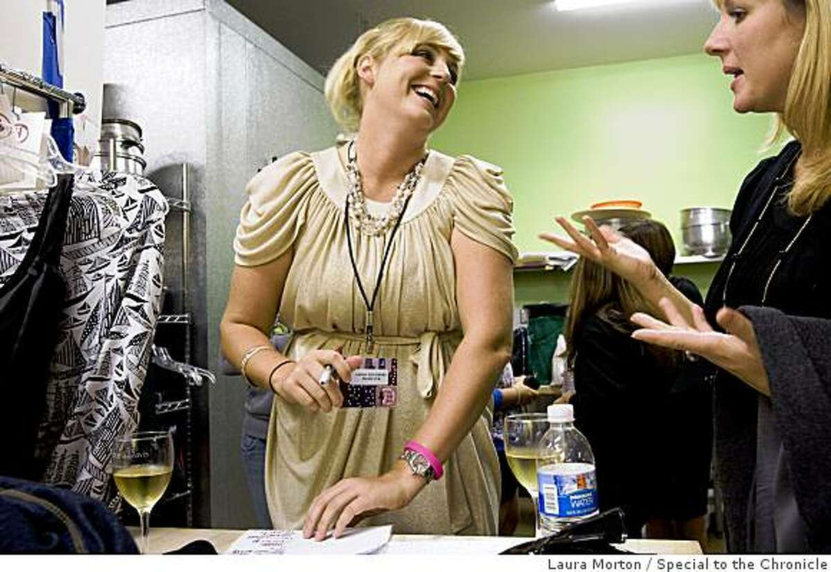Producer Sarah Haggberg laughs with friends backstage before Bryant Park West, a charity fashion show at Jacuzzi Winery in Sonoma, Calif., on Saturday, November 22, 2008. Haggberg produced the show.