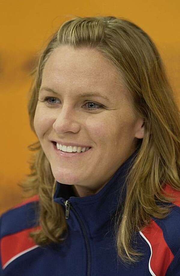 FILE - In this Oct. 7, 2004, file photo, United States swimmer Jenny Thompson answers a question during a news conference in Indianapolis. Thompson told WBZ-TV on Wednesday, June 30, 2010, that she was riding her scooter in Brookline, Mass., on Monday night when a vehicle stopped behind her with its headlights out. She says two people got out, punched her, pushed her down and tried to grab her ride.  Thompson held onto the scooter and screamed for help, forcing the assailants to flee on foot. The 37-year-old suffered a cut on her nose and several scrapes and was treated at the scene. Photo: Darron Cummings, File, AP