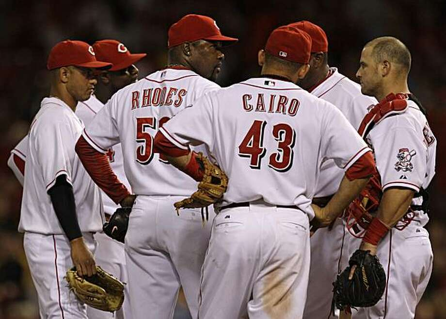 Cincinnati Reds relief pitcher Arthur Rhodes (53) is taken out of their baseball game against the Philadelphia Phillies in the 10th inning, Tuesday, June 29, 2010, in Cincinnati. Rhodes gave up three runs in the inning ending his record tying streak of 33straight scoreless appearances. Also pictured are, left to right, Orlando Cabrera, Brandon Phillips, Miguel Cairo (43), manager Dusty Baker, and Ramon Hernandez. Photo: Al Behrman, AP