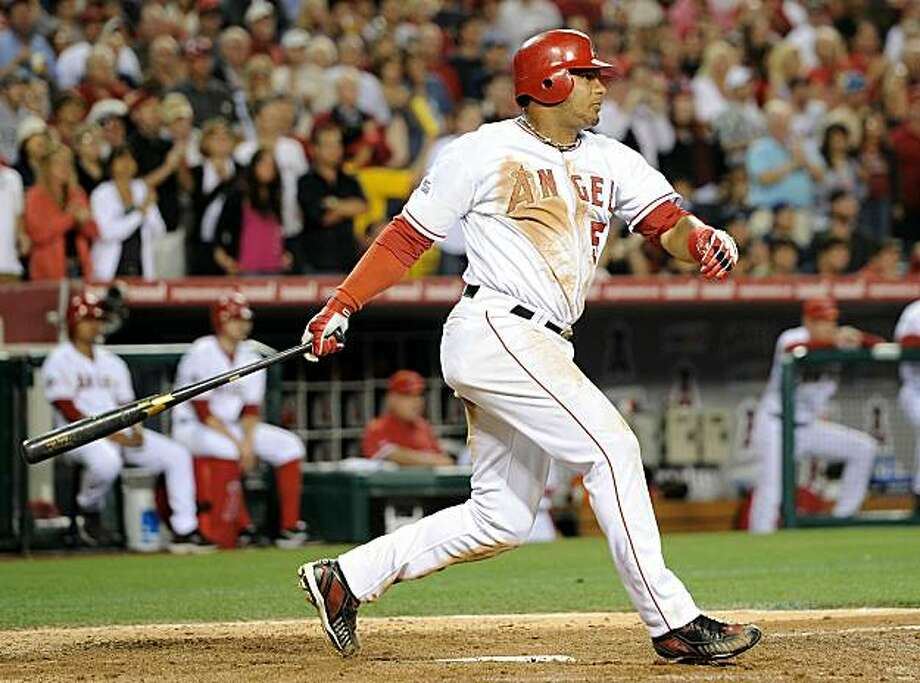 ANAHEIM, CA - JUNE 29:   Bobby Abreu #53 of the Los Angeles Angels hits a three run double to take a 6-3 lead over the Texas Rangers during the sixth inning at Angel Stadium on June 29, 2010 in Anaheim, California. Photo: Harry How, Getty Images