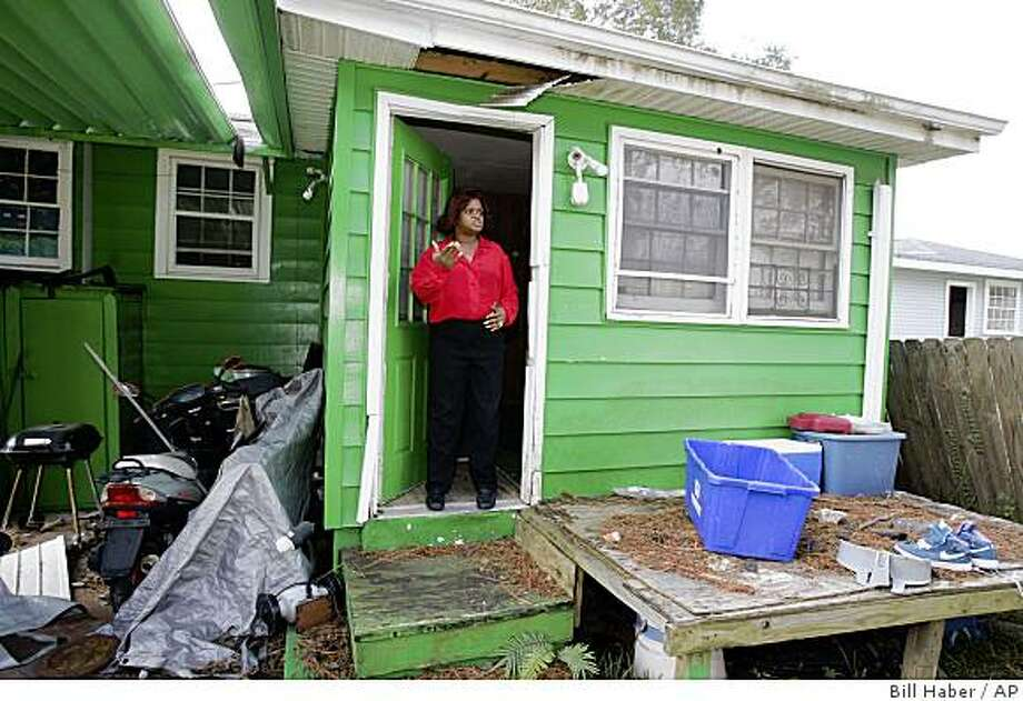 Sandra Marshall gives a tour of her rental property in New Orleans, Wednesday, Oct. 22, 2008. Marshall is still working her way through programs to help her recover from damage caused by Hurricane Katrina. (AP Photo/Bill Haber) Photo: Bill Haber, AP