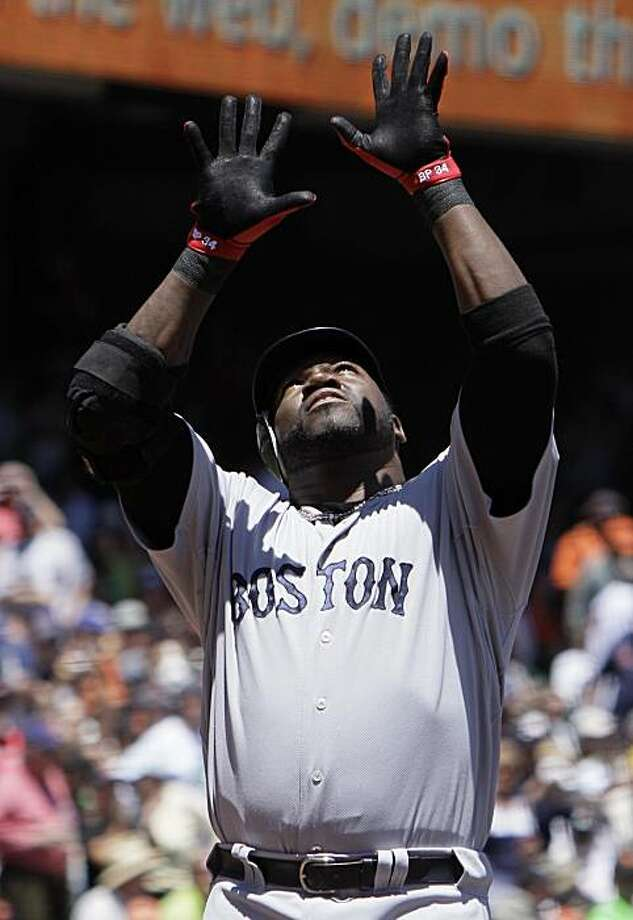 Boston Red Sox' David Ortiz gestures crossing home plate after hitting a home run off San Francisco Giants starting pitcher Tim Lincecum during the first inning of their  interleague baseball game in San Francisco, Sunday, June 27, 2010. Photo: Eric Risberg, AP
