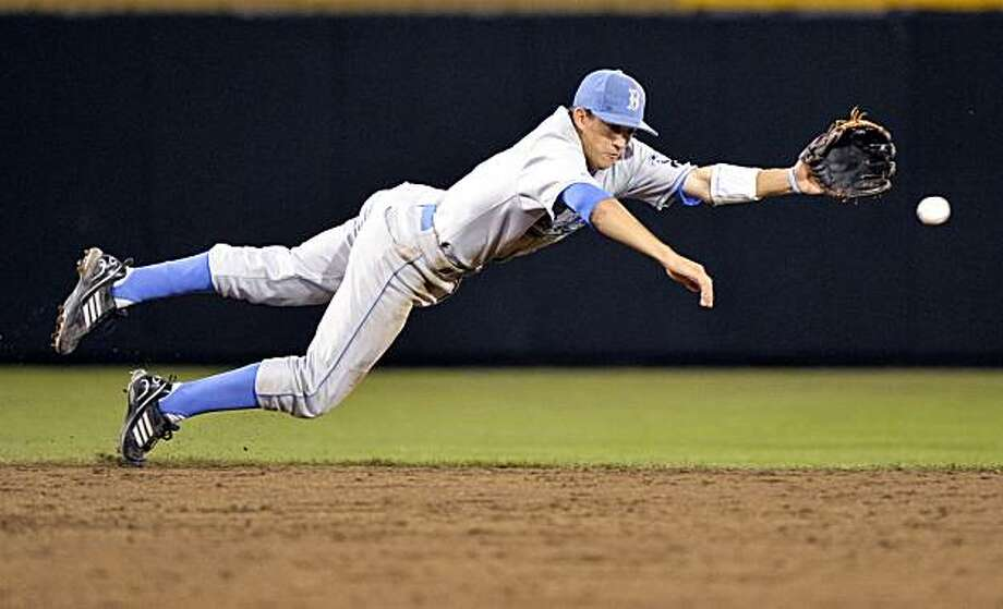 UCLA shortstop Niko Gallego dives for, but misses a ball hit by South Carolina's Adam Matthews, in the eighth inning of game two of the best-of-three NCAA College World Series baseball finals, in Omaha, Neb., Tuesday, June 29, 2010. Photo: Ted Kirk, AP