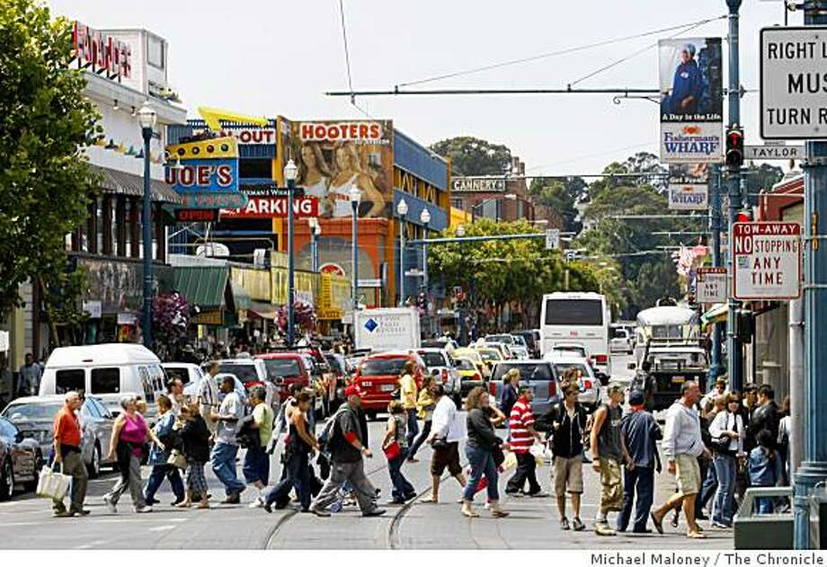 A view of crowded Jefferson Street in Fisherman's Wharf on August 19, 2008.The city is proposing to spend about $10 million to widen the main drag at Fisherman's Wharf and add bike lanes, wider sidewalks and better landscaping. Photo: Michael Maloney, The Chronicle