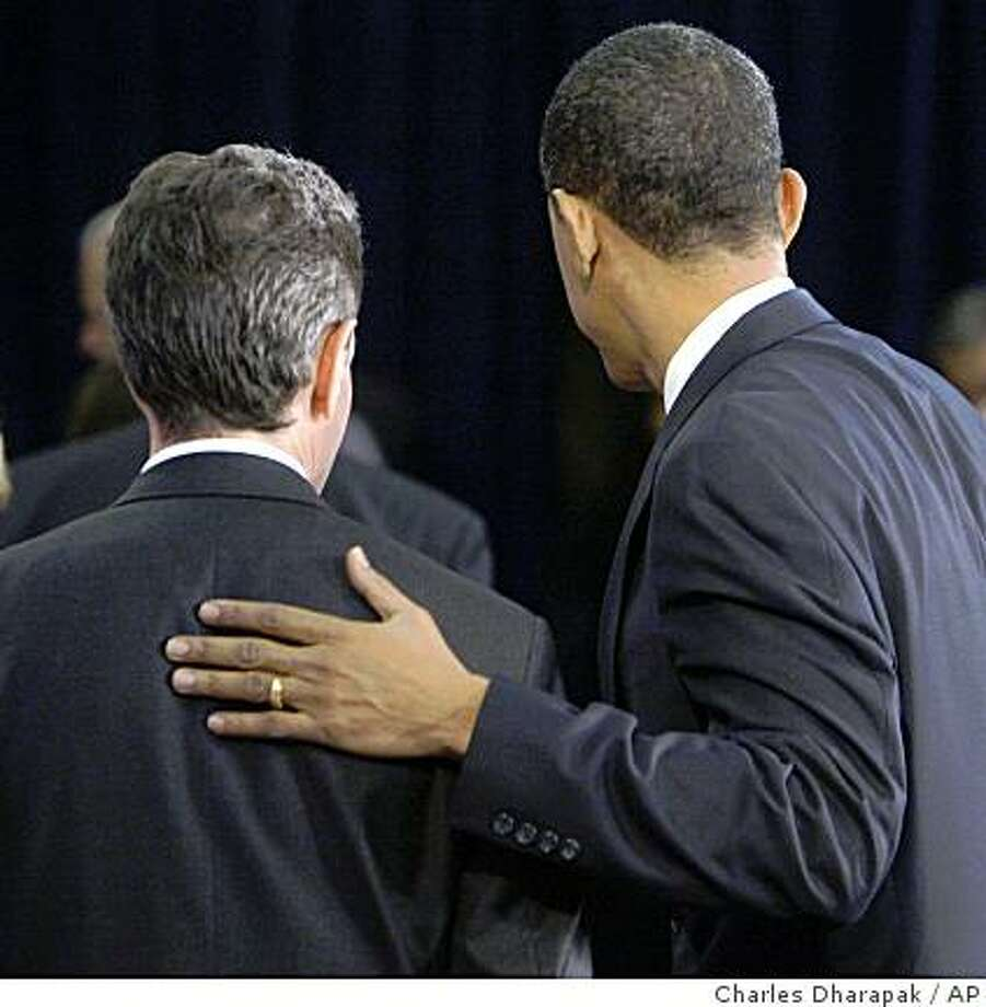 President-elect Barack Obama walks away with Treasury Secretary-designate Timothy Geithner after a news conference in Chicago, Monday, Nov. 24, 2008. (AP Photo/Charles Dharapak) Photo: Charles Dharapak, AP