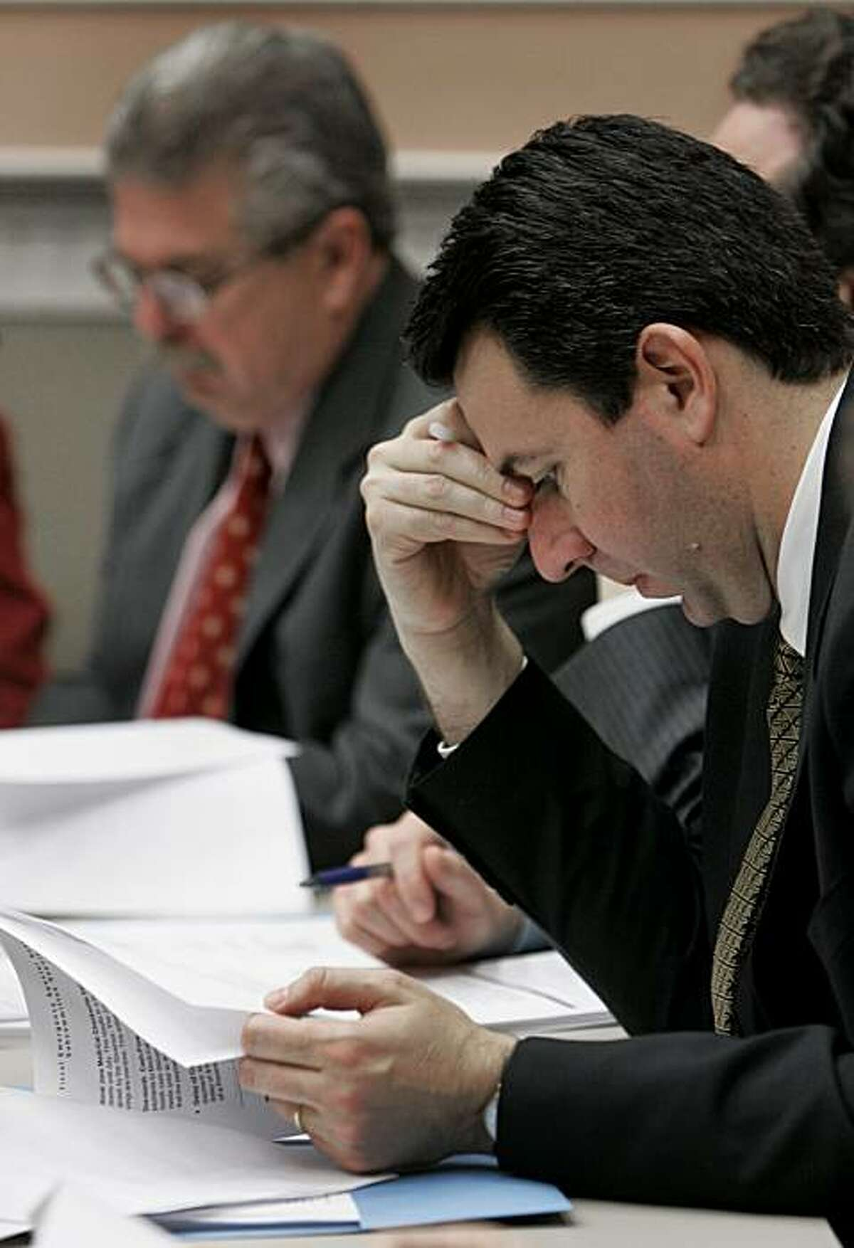 Assemblyman Hector de La Torre, D-South Gate, looks over briefing papers on the state budget during a Assembly Budget Committee hearing, at the Capitol in Sacramento, Calif., Thursday, Feb. 14, 2008. The committee approved a package of bills to cut $3.3 billion in the current state budget. (AP Photo/Rich Pedroncelli)