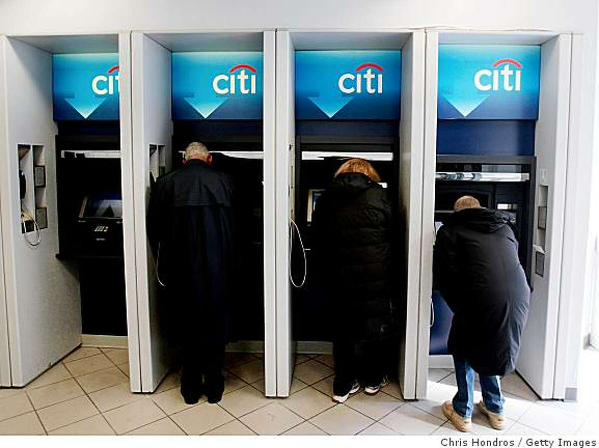 NEW YORK - NOVEMBER 24: People withdraw money at a Citibank ATM location November 24, 2008 in New York. Citibank shares and the U.S. market rose sharply after the federal government moved to shore up Citibank and President-Elect Barack Obama announced plans to stimulate the economy once he takes office. (Photo by Chris Hondros/Getty Images)