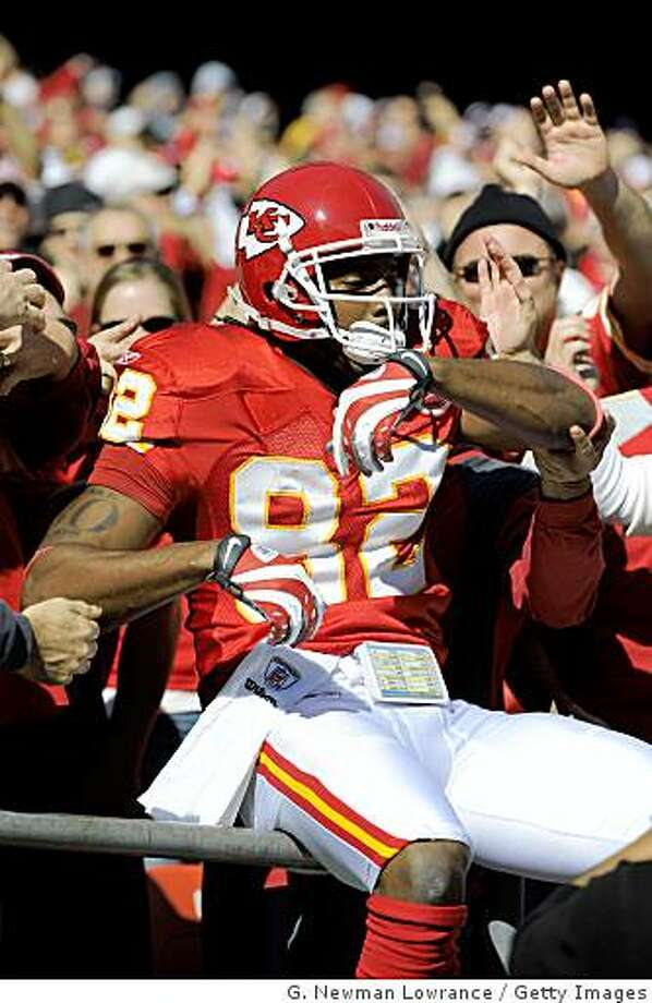 KANSAS CITY, MO - NOVEMBER 16:  Dwayne Bowe #82 of the Kansas City Chiefs celebrates with fans following a touchdown against the New Orleans Saints on November 16, 2008 at Arrowhead Stadium in Kansas City, Missouri.  (Photo by G. Newman Lowrance/Getty Images) Photo: G. Newman Lowrance, Getty Images