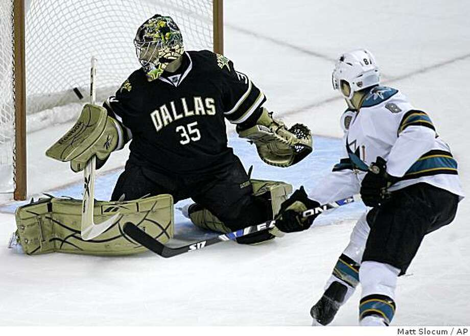 Dallas Stars goalie Marty Turco (35) watches the puck fly over his shoulder for a goal by San Jose Sharks forward Joe Pavelski (8) during the first period of an NHL hockey game, Friday, Nov. 28, 2008, in Dallas. (AP Photo/Matt Slocum) Photo: Matt Slocum, AP