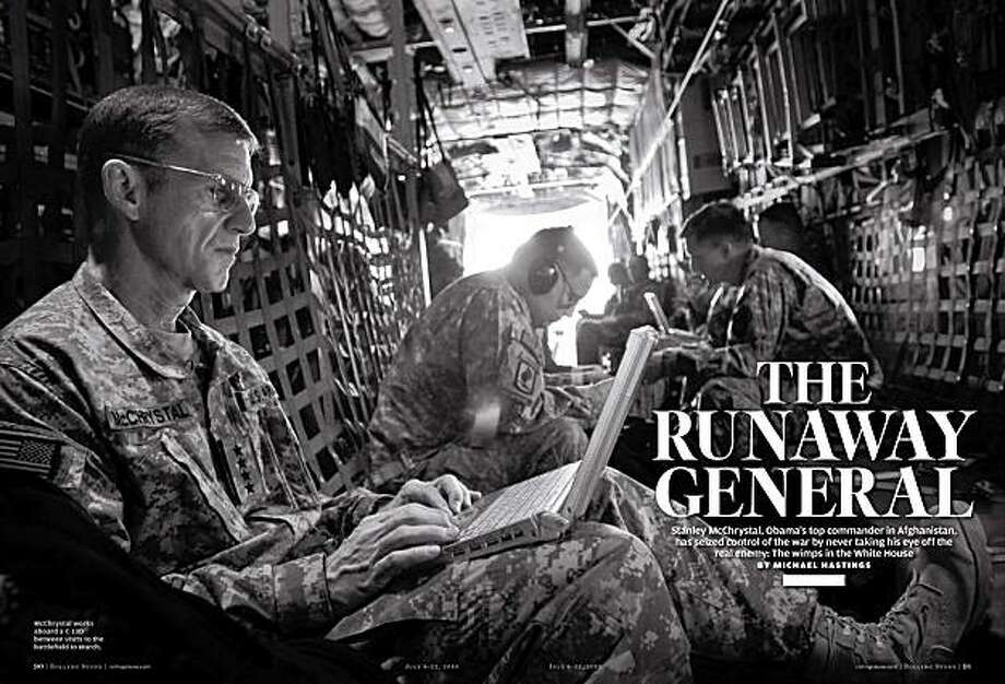 """This March 15, 2010 image provided Tuesday, June 22, 2010  by Rolling Stone magazine shows a layout from the magazine's latest issue with a US Navy/NATO photo of Gen. Stanley A. McChrystal on board a C-130 aircraft over Afghanistan. McChrystal was fighting for his job Tuesday after being summoned to Washington to explain his extraordinary complaints about President Barack Obama and his colleagues in the Rolling Stone article.  McChrystal, who publicly apologized Tuesday for using """"poor judgment"""" in the interview, has been ordered to appear at the White House on Wednesday.  (AP Photo/Rolling Stone, US Navy/NATO, Navy Petty Officer 1st Class Mark O'Donald)   NO SALES Photo: AP"""