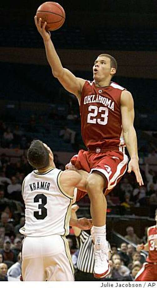 Oklahoma's Blake Griffin draws a foul while shooting against Purdue's Chris Kramer in the second half during the championship game of the NCAA preseason NIT college basketball tournament Friday, Nov. 28, 2008 at Madison Square Garden in New York. Oklahoma won 87-82.(AP Photo/Julie Jacobson) Photo: Julie Jacobson, AP