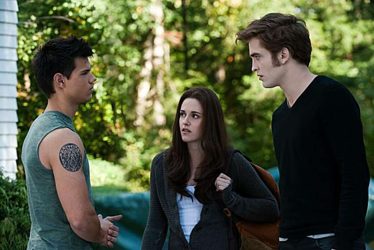 Taylor Lautner, from left, Kristen Stewart and Robert Pattinson star in