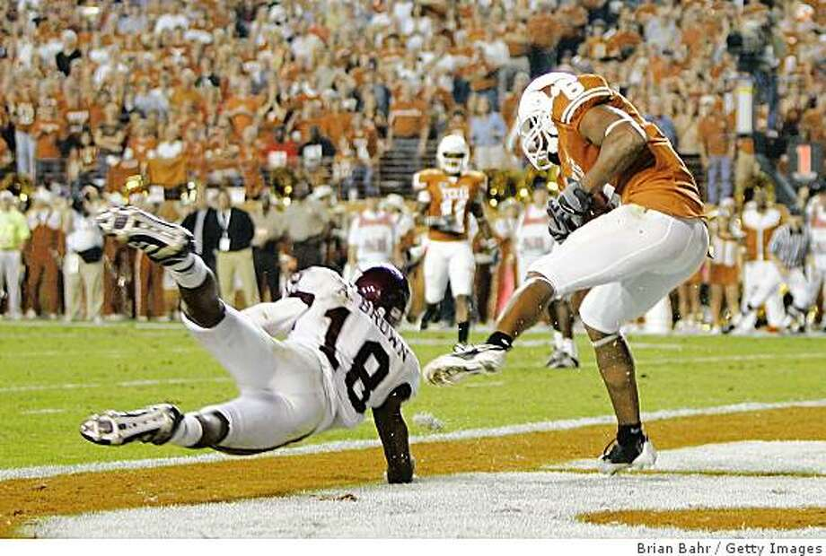 AUSTIN, TX - NOVEMBER 27:  Wide receiver Quan Cosby #6 of the Texas Longhorns grabs a pass for a touchdown against defensive back Arkeith Brown #18 of the Texas A&M Aggies in the final minute of the second quarter at Darrell K Royal-Texas Memorial Stadium November 27, 2008 in Austin, Texas.  (Photo by Brian Bahr/Getty Images) Photo: Brian Bahr, Getty Images