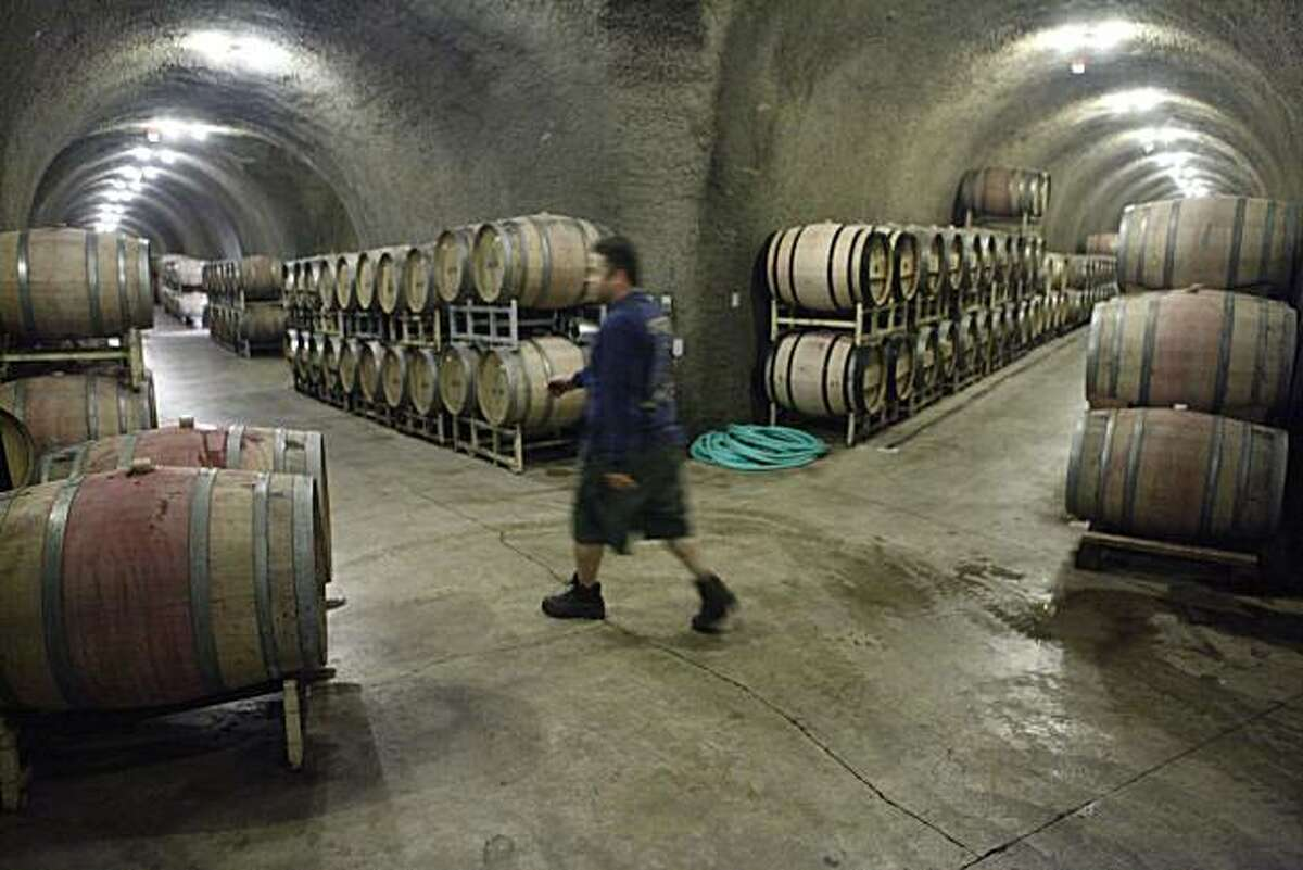 Alex Gonzalez, 1st Cellar Bottling supervisor at Chateau Montelena, walks through barrels of wine in the cellar on Wednesday June 16, 2010 in Calistoga, Calif.