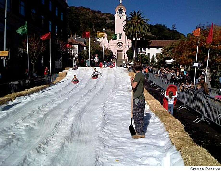 As part of  San Rafael's 29th Annual Parade of Lights and Winter Wonderland, one block of A Street between Fourth Street and Fifth Avenue will turn into a free sledding track. Photo: Steven Restivo