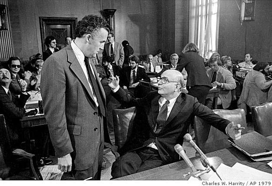 Chairman of the Federal Reserve Board, Paul Volcker, right, has a word with Sen. Paul Sarbanes, D-Maryland, a member of the Senate Banking Committee, prior to appearing before the panel, Oct. 15, 1979, in Washington. The group is conducting oversight hearings to review conduct of monetary policy and recent actions by the Federal Reserve. (AP Photo/Charles W. Harrity) Photo: Charles W. Harrity, AP 1979