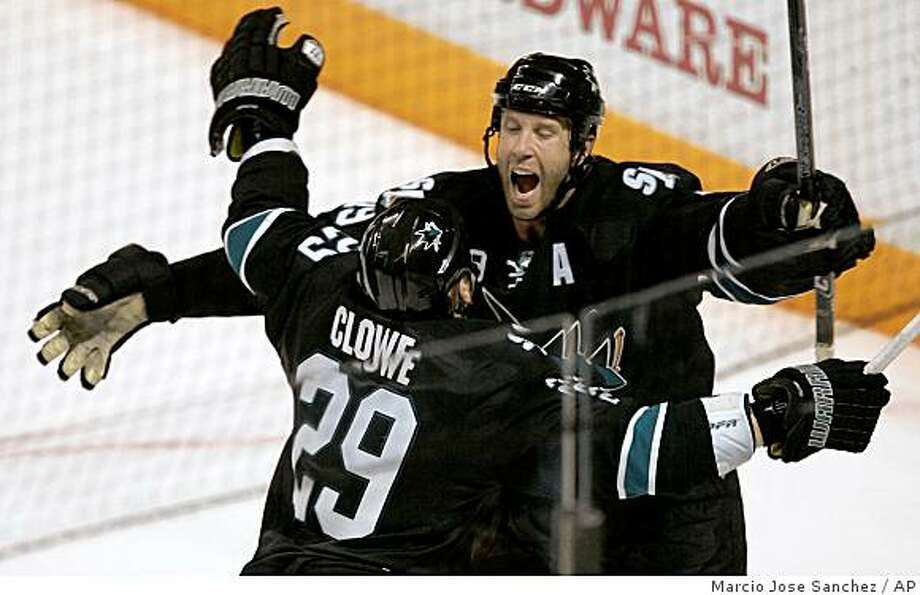 San Jose Sharks center Joe Thornton, top, celebrates with Ryane Clowe after Thornton's game-winning goal in overtime against the Chicago Blackhawks in an NHL hockey game in San Jose, Calif., Wednesday, Nov. 26, 2008. San Jose won 3-2. (AP Photo/Marcio Jose Sanchez) Photo: Marcio Jose Sanchez, AP
