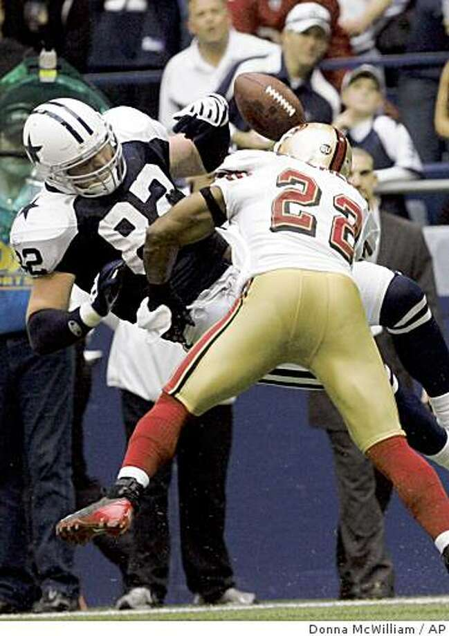 Dallas Cowboys tight end Jason Witten (82) takes a hard hit from San Francisco corner back Nate Clements (22) on an incomplete pass in the third quarter during an NFL football game, Sunday, Nov. 23, 2008, in Irving, Texas. Witten was injured on the play.  (AP Photo/Donna McWilliam) Photo: Donna McWilliam, AP