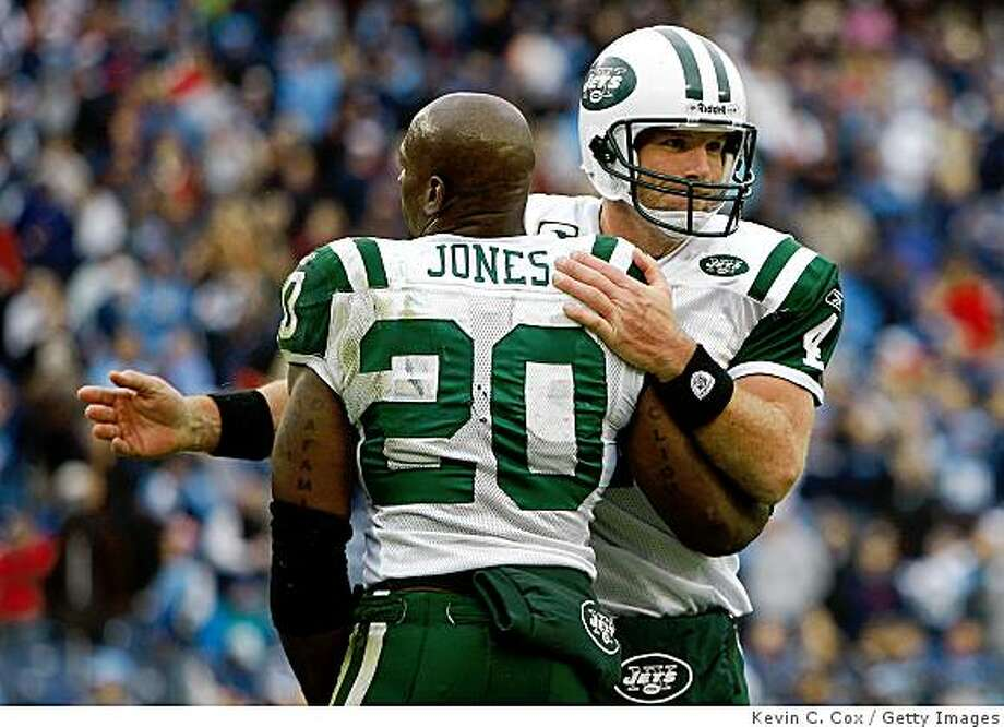 NASHVILLE, TN - NOVEMBER 23:  Quarterback Brett Favre #4 of the New York Jets celebrates with Thomas Jones #20 after a touchdown against the Tennessee Titans during the game at LP Field on November 23, 2008 in Nashville, Tennessee.  (Photo by Kevin C. Cox/Getty Images) Photo: Kevin C. Cox, Getty Images