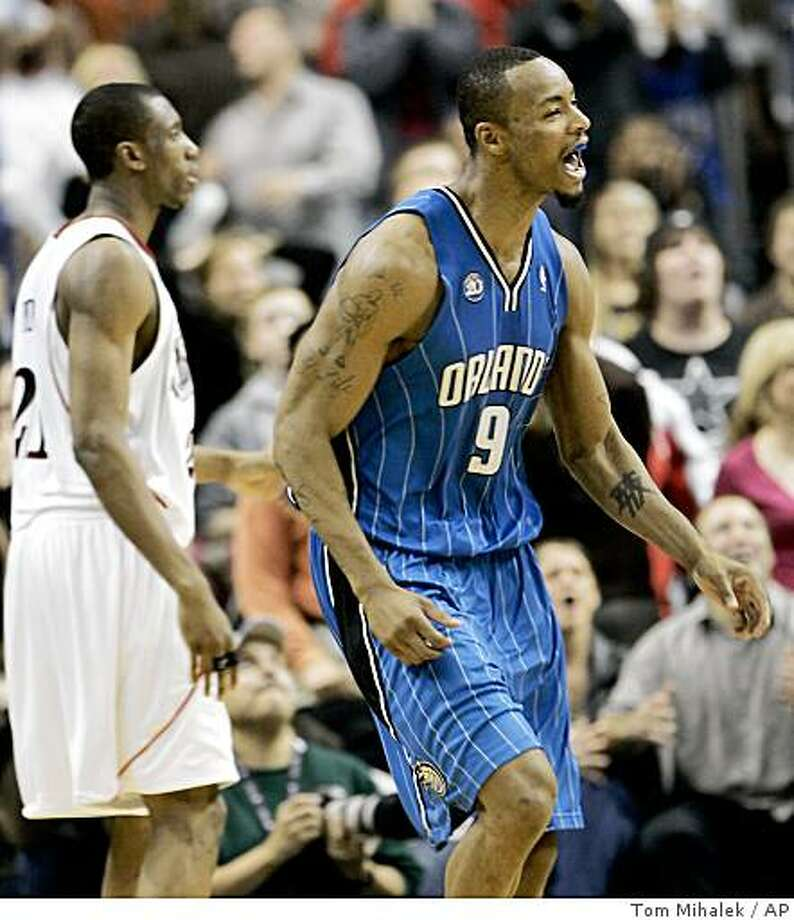 Orlando Magic forward Rashard Lewis shouts after sinking a 3-point shot with less than five seconds left in the second half of an NBA basketball game against the Philadelphia 76ers, Wednesday, Nov. 26, 2008, in Philadelphia. Looking on at left is Philadelphia's Thaddeus Young. Orlando won 96-94. (AP Photo/Tom Mihalek) Photo: Tom Mihalek, AP