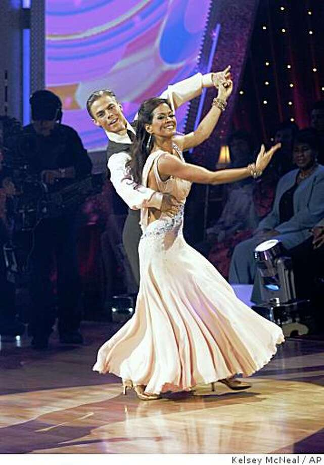 """In this image provided by ABC-TV Brooke Burke dances with her partner Derek Hough Tuesday Nov. 25, 2008. Burke waltzed away with the mirror ball trophy on the """"Dancing with the Stars"""" finale. The 37-year-old TV personality and mother of four dominated the seventh season of the popular ABC dancing competition and bested former NFL player Warren Sapp and former 'NSync member Lance Bass during the Tuesday night finale, in which she reprised an emotional Viennese waltz routine that earned her a perfect score from the show's panel of judges. (AP Photo/ABC - KELSEY MCNEAL) BROOKE BURKE, DEREK HOUGH Photo: Kelsey McNeal, AP"""