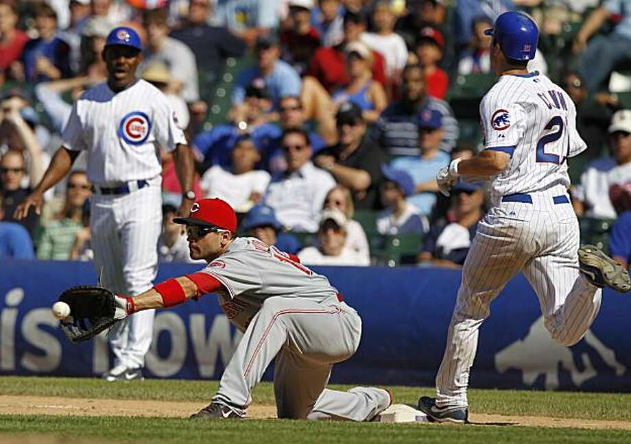 Chicago Cubs' Tyler Colvin beats the throw to Cincinnati Reds' Joey Votto, but he was called out on the play in the 10th inning at Wrigley Field in Chicago, Illinois, on Thursday, July 1, 2010. (Scott Strazzante/Chicago Tribune/MCT) Photo: Scott Strazzante, MCT