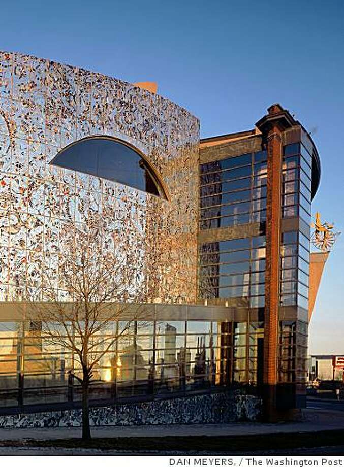 The American Visionary Art Museum is on Baltimore's waterfront in Baltimore. The building itself is a unique statement, covered with fragments of mirror and tile and adorned with a looming Masonic eye. Photo: DAN MEYERS,, The Washington Post