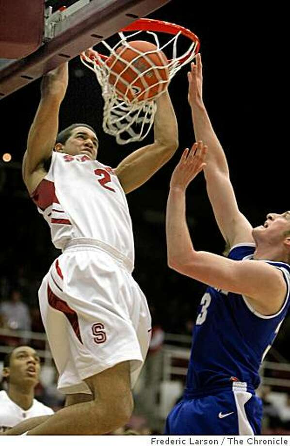Stanford's Landry Fields stuffs the ball over Mike McLain of the Air Force Falcons in the first half at Maples Pavilion in Palo Alto, Calif., on Wednesday, Nov. 26, Photo: Frederic Larson, The Chronicle