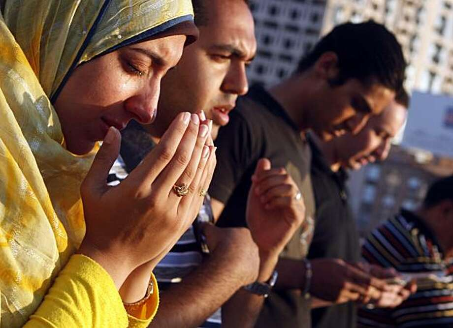 An Egyptian protestor cries during special prayers for 28-year-old Khaled Said, at the Mediterranean port city of Alexandria, Egypt, Friday, June 25, 2010. The family of Khaled Said claim that he died after the police beat him to death on an Alexandria street after he posted a video on the Internet of officers sharing the spoils from a drug bust among themselves. Photo: Amr Nabil, AP