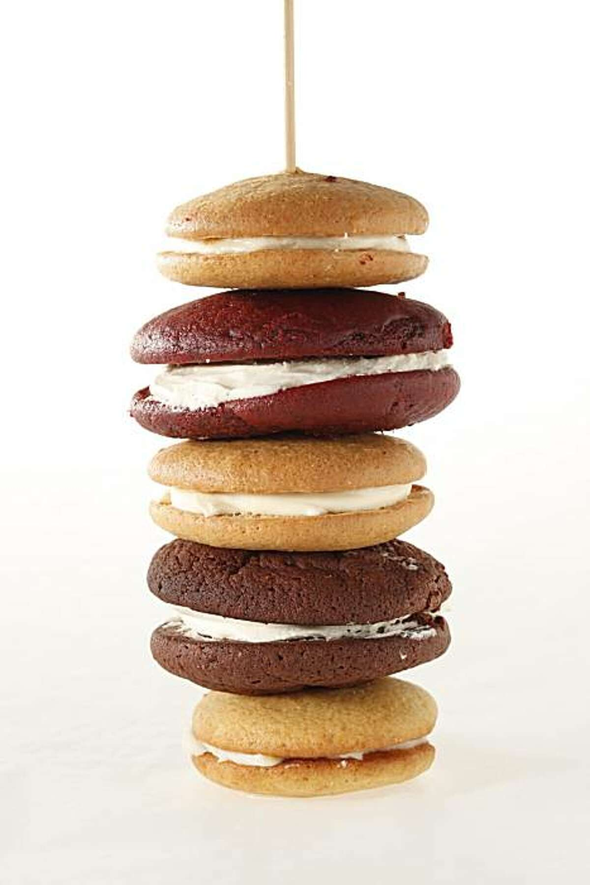 Whoopie Pie, stacks of 1) Red velvet w marshmallow filling ; 2) Chocolate (traditional) ones w