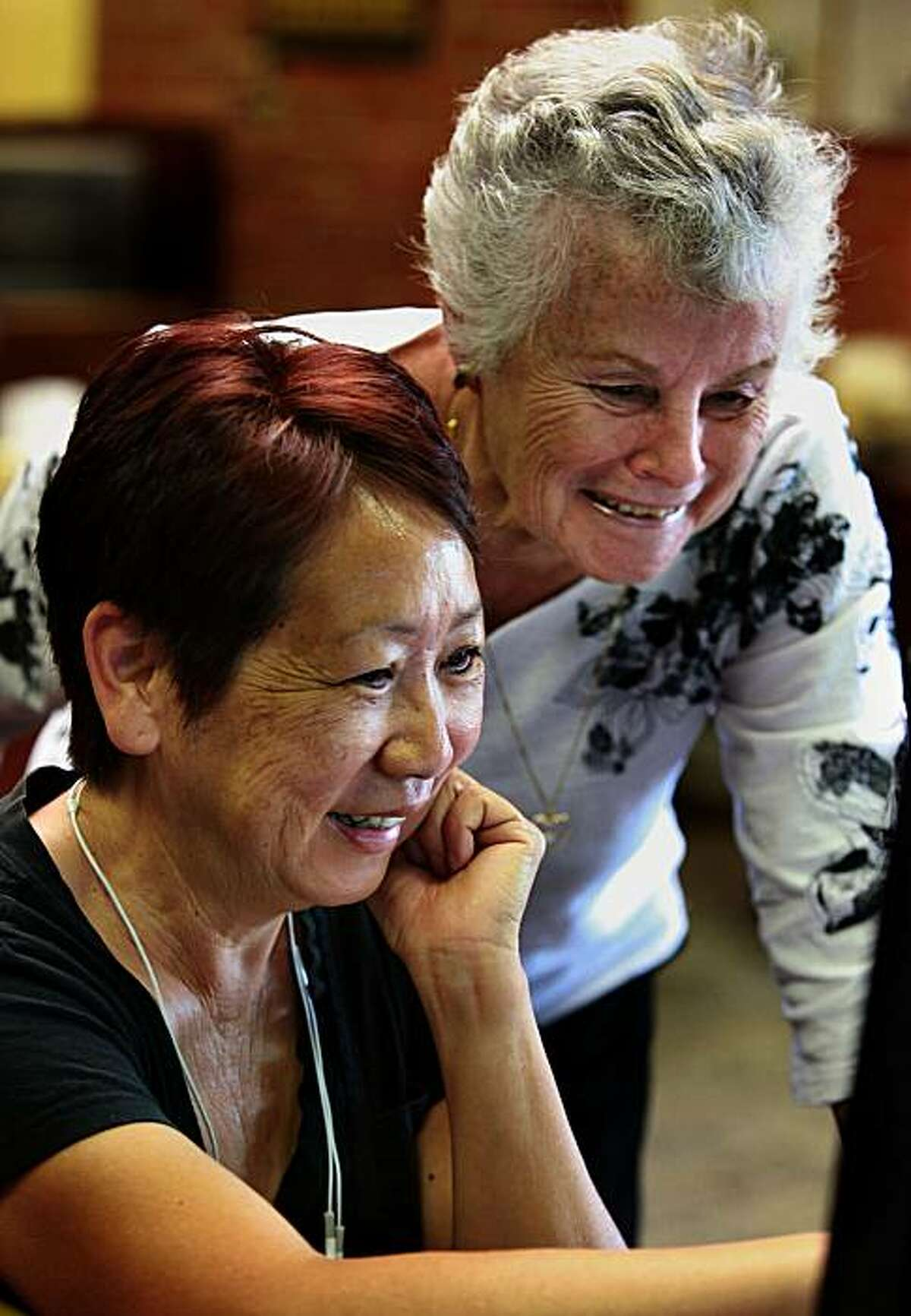 Volunteer Marilyn Hosfeldt (back) helping Frances Lim (front) of Palo Alto find articles on hip replacement in the Stanford Health Library at the Stanford Shopping Center in Palo Alto, Calif., on Tuesday, June 22, 2010, Frances Lim has a 92 year old family member who is going to see a doctor about hip replacement. Starting 21 years ago the library has 80 volunteers.